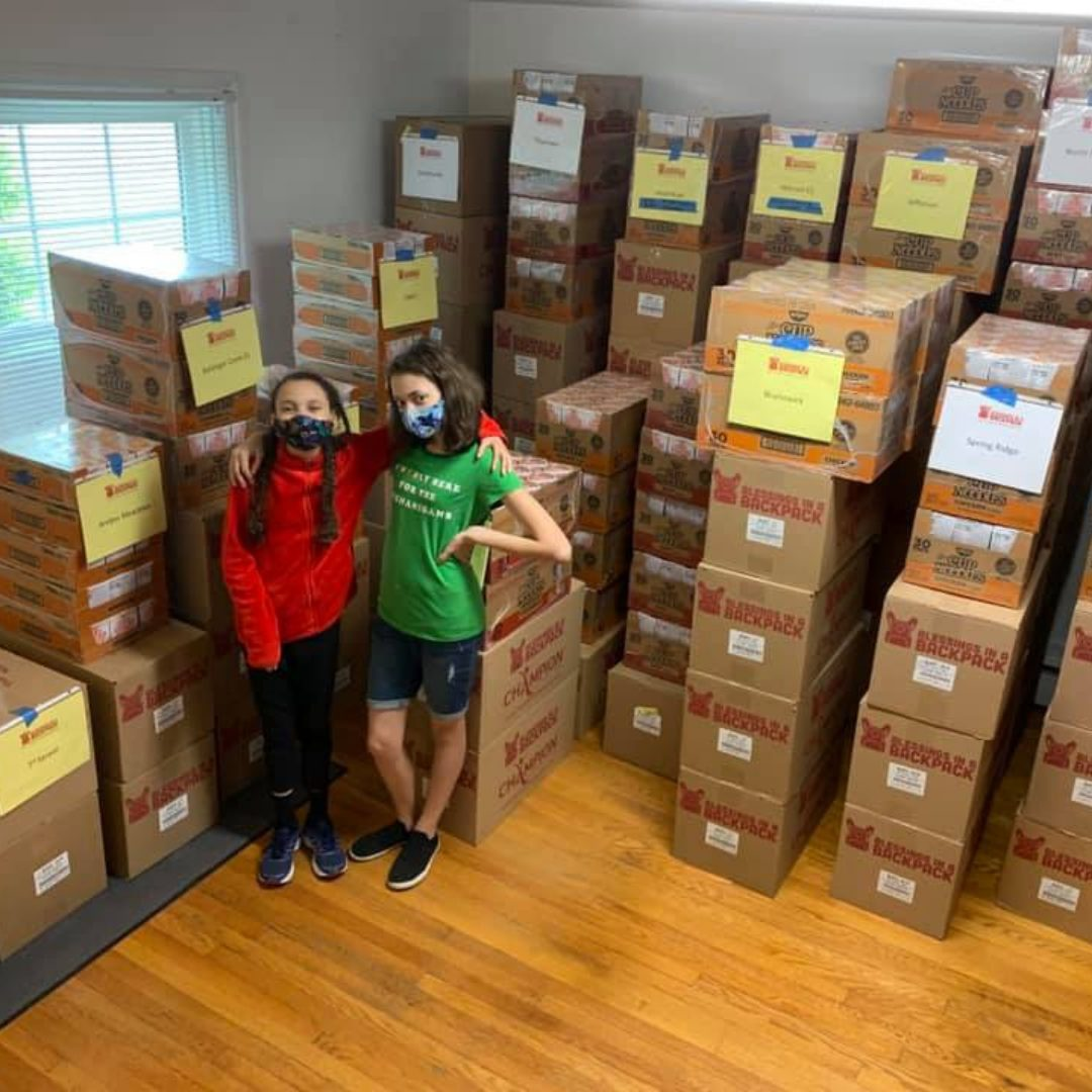 Girls posing with boxes from Sysco