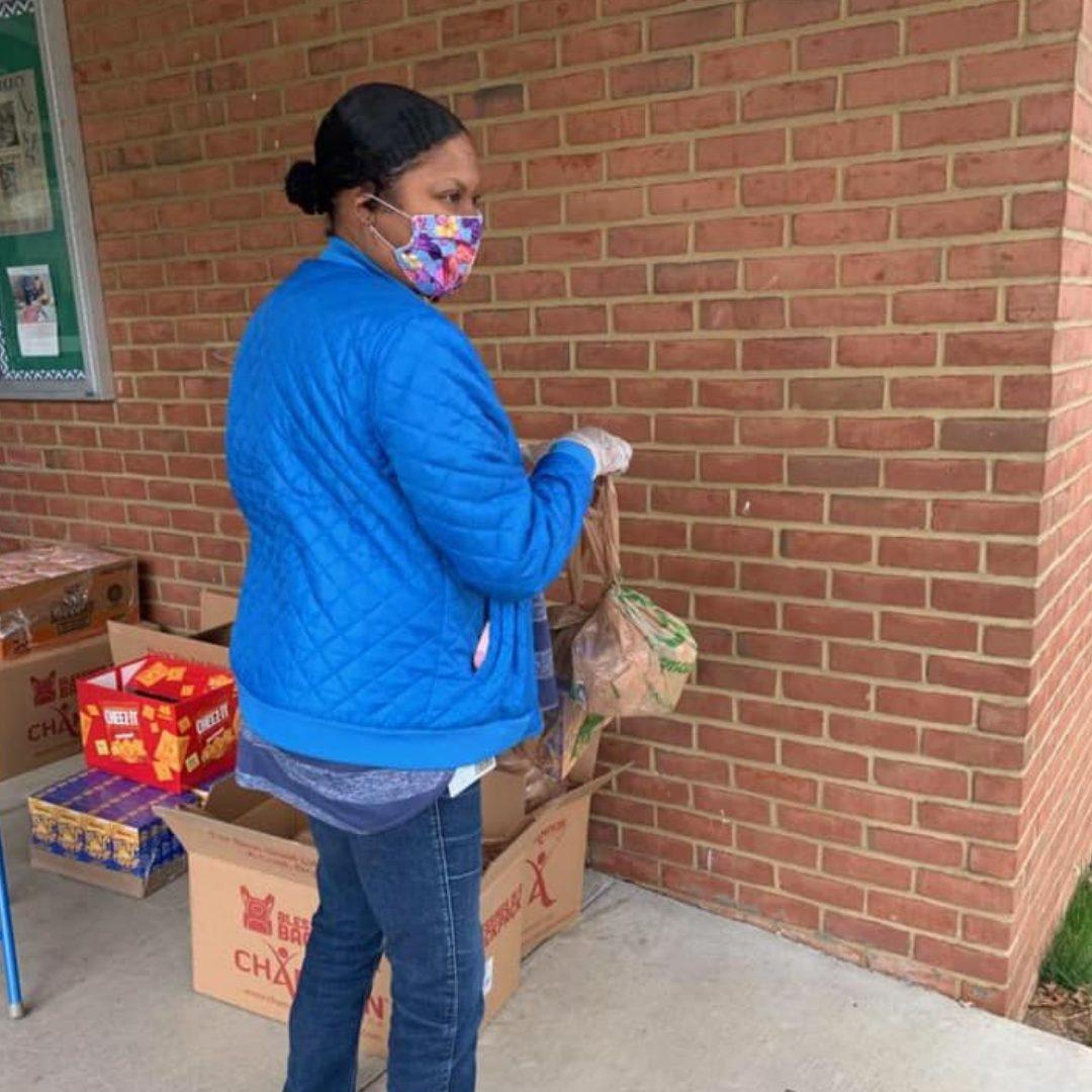 Woman distributing food