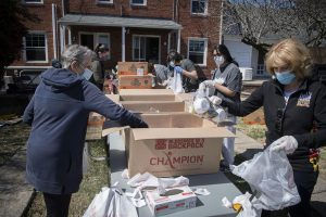Blessings in a Backpack pop-up outdoor events help feed hungry kids, reunite volunteers