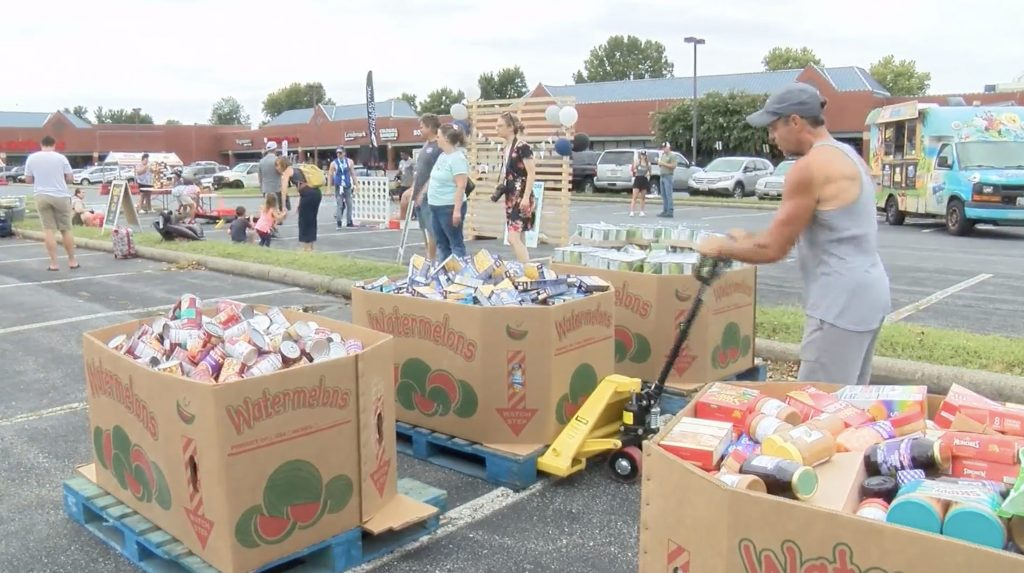 Frederick church sweeps shelves of local grocery store, donates items to local charities